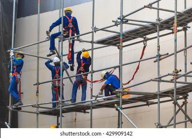 Bangkok - May 30th, 2016: Construction workers installing scaffolding storage tank.