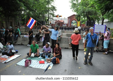 BANGKOK - MAY 31: Nationalist multi-color protesters rally outside Thai Parliament in opposition to a reconciliation bill that would grant amnesty to opponents on May 31, 2012 in Bangkok, Thailand.