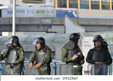 BANGKOK - MAY 31: Thai soldiers in riot gear secure a shopping district in preventing anti-coup protests on May 31, 2014 in Bangkok, Thailand. Thailand is experiencing its 19th military coup.