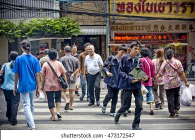 BANGKOK - MAY 4 : People crossing the street in Chinatown on MAY 4, 2016 in Bangkok, Thailand. Chinatown is one of the most popular attraction in Bangkok.