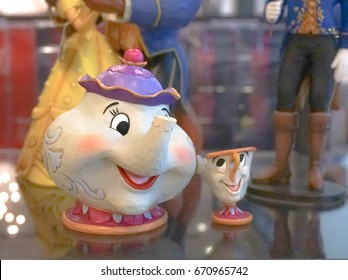 BANGKOK - MAY 6, 2017 : Disney Merchandise of Mrs. Potts & chips, Supporting Characters from Disney's 1991 film Beauty and the Beast. Slightly noise for aged filter. Soft focus. Editorial used only.
