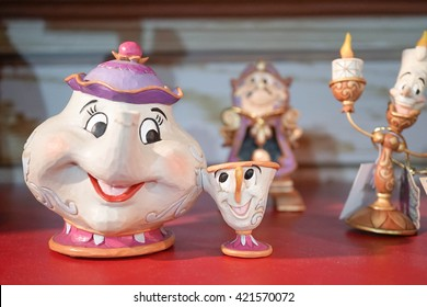 BANGKOK - MAY 7, 2016 : Merchandise of Mrs. Potts & chips, Abstract Blur of Cogsworth & Lumiere on background. Supporting Characters from 1991 film Beauty and the Beast.