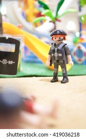 BANGKOK - MAY 7, 2016 : Playmobil Police officer in uniform at the crime scene, location : beach. Police & Murder concept. Playmobil belongs to a toy company, the Brandstatter Group, in Germany.