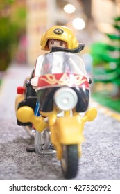 BANGKOK - MAY 7, 2016 : Portrait shot of Playmobil Biker on his motorbike. Adventure and Travel concept. Playmobil belongs to a toy company, the Brandstatter Group, in Germany. Soft Focus.