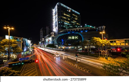 BANGKOK MBK April 28 : at early night with typically heavy traffic on the roads. It is the most famous shopping mall in Bangkok, Thailand. Many tourists come to enjoy shopping here. Bangkok 2015