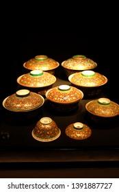 Bangkok National Museum, Bangkok, Thailand - April 2019 : Display of Benjarong, a traditional Thai five-colored famous porcelain in the Rattanakosin period.