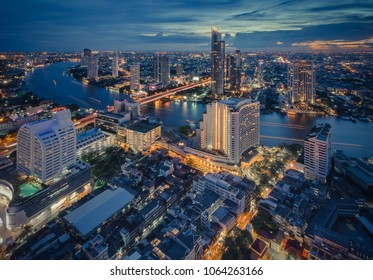 Bangkok night cityscape with modern buildings and street light, vintage style process