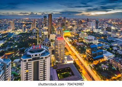Bangkok night cityscape with modern buildings and street light