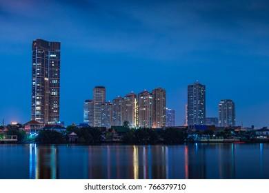 Bangkok night view from boat on Chaopraya river, Thailand