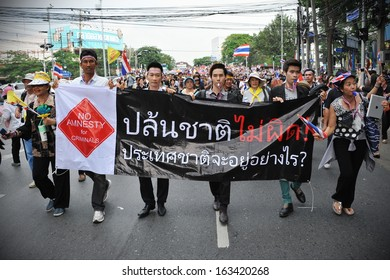 BANGKOK - NOV 11: Unidentified protesters march through the Thai capital to join a large anti-government rally on Nov 11, 2013 in Bangkok, Thailand.