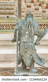 Bangkok, Nov 24, 2017: Statue at Wat Arun Ratchawaram . It is Monumental Buddhist temple with an iconic, ornately tiled central prang is located right on the river in Bangkok, Thailand,