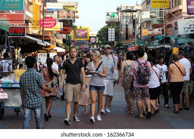 BANGKOK - NOVEMBER 10: Unidentified tourists walk along backpacker haven Khao San Road on November 10, 2013 in Bangkok, Thailand.