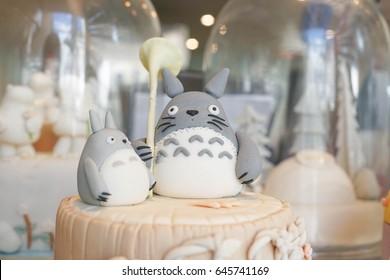 Bangkok - November 12, 2016 : Detail of sugar icing on top of personalised birthday cake. Totoro is on top of a cake. Totoro is a famous Japanese cartoon character from Gibli studio.Editorial Use Only