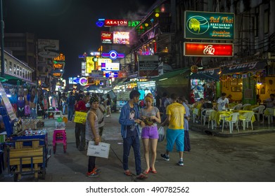 BANGKOK - NOVEMBER 17, 2014: Tourists and vendors share the pedestrianized street on a typical night in the backpacker nightlife center of Khao San Road.