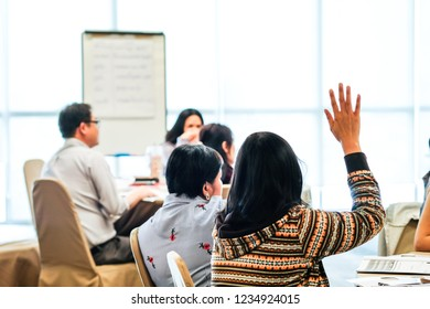 BANGKOK - November 2018: Students raising their hands and asking questions to the teacher November 16, 2018 in Bangkok, Thailand.