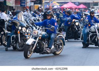 BANGKOK - NOVEMBER 28: 250 Harley-Davidson motorbikes paraded on November 28, 2009 through Bangkok, Thailand. To honor the monarch of Thailand, H.M. King Bhumipol Adulyadej, one week before his birthday.