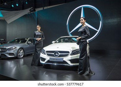 BANGKOK - November 30, 2016 : Unidentified model with mercedes-benz car on display at the Thailand International Motor Expo 2016 on November 30, 2016 in Bangkok, Thailand.