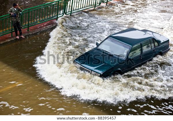 BANGKOK - NOVEMBER 5: A car navigates through the flood on Phahonyothin Road during the worst flooding in Bangkok, Thailand on November 5, 2011.