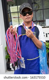 BANGKOK - NOVEMBER 8, 2013 : Whistle salesman in Anti-government protest at Democracy Monument on November 8, 2013 in Bangkok, Thailand. The protest Against The Amnesty bill in capital of Thailand