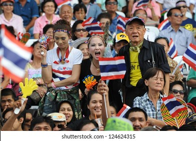 BANGKOK - OCT 28: Supporters of the nationalist group Siam Pitak rally at the Royal Turf Club calling for the military to overthrow the government on Oct 28, 2012 in Bangkok, Thailand.