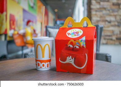 BANGKOK - OCTOBER 10 : Happy meal set ,in soft focus, with blurred Ronald Mcdonald at McDonald's restaurant on October 10, 2017 in Bangkok, Thailand