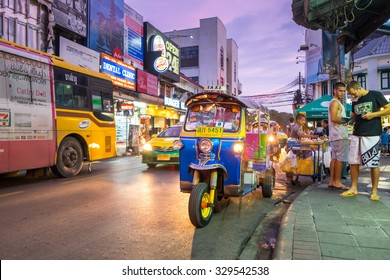 BANGKOK - OCTOBER 17: Tuk-tuks waiting passengers on Khao San Road in the evening. on October 17, 2015 in Bangkok, Thailand.