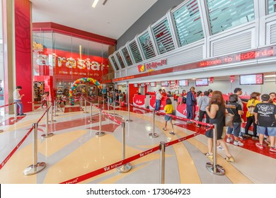 BANGKOK - OCTOBER 29 : People buying tickets at Kidzania, on October 29, 13 in Bangkok. KidZania is a Mexican chain of family entertainment centers for children to work in adult jobs and earn currency