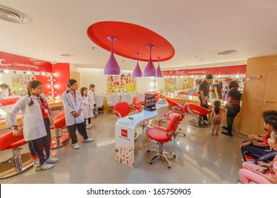 BANGKOK - OCTOBER 29:Unidentified kids at beauty shop, Siam Paragon, on October 29, 13 in Bangkok. KidZania is a Mexican chain of family entertainment centers for children to work and earn currency