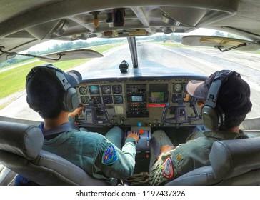 Bangkok, October 7, 2018: Captain of the Royal Rain Department Take the plane to do rain for farmers.