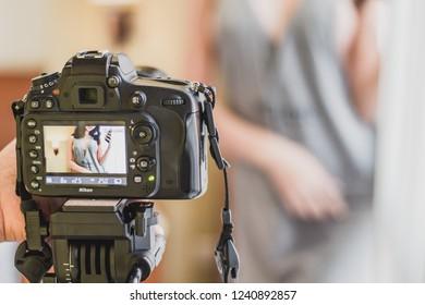 Bangkok, Thailand on November 17, 2018 , photographers used black camera brand Nikon.Shooting her in the studio , soft focus , blurred.