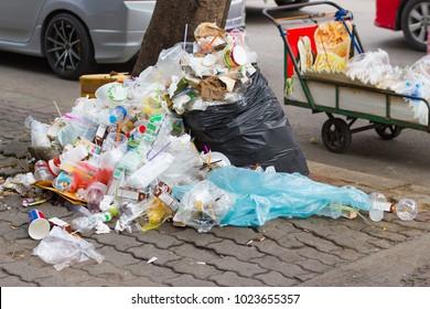 Bangkok province, Thailand:- January 8, 2018:- The streets of Bangkok Piles of garbage dumped along the road.