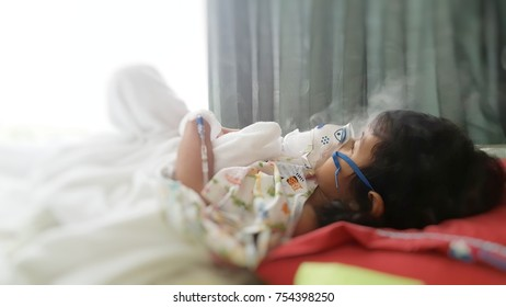 Bangkok Rayong hospital,rayong,Thailand. 14 November 2017. yong asian girl sleep on bed in hospital with nebulizer mask for breathing treatment. health equipment.