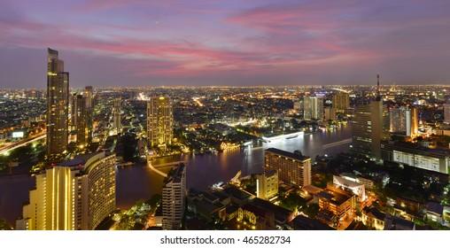 Bangkok river view at Dusk with modern business building along the Chao Phraya river ,Thailand