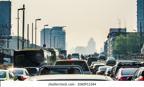 Bangkok rush hour haevy trafic jam in the morning, buildings in mist as background.