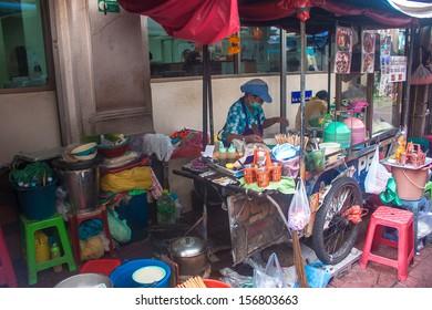 BANGKOK - SEP 6 : A street vendor sells soups on Sep 6, 2013 in Bangkok, Thailand. According gov stats there are over 16,000 registered street vendors in Bangkok.