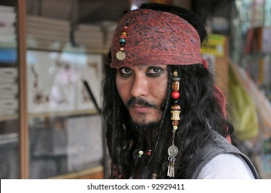 BANGKOK - SEPT 11: An unidentified man poses as Jack Sparrow from Pirates of the Caribbean movie franchise at an informal cosplay meet at Chatuchak Weekend Market Sept 11, 2011 in Bangkok, Thailand.