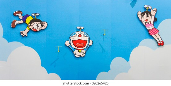 BANGKOK - SEPT 12, 2015 : A Photo of Doraemon and friends paper pop up on a painted wall with blue sky, displayed at Central West Gate, Thailand. Set up for Photo Shot Corner. NOT TOY FIGURINE