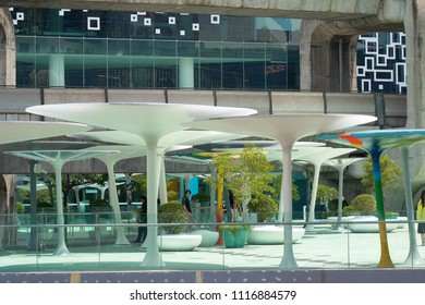 BANGKOK - SEPTEMBER 13, 2017: Skywalk between Siam Discovery and MBK - two famous shopping malls in downtown of Bangkok.
