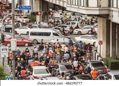 BANGKOK - September 15: Traffic chaos in Bangkok, Thailand at Asoke intersection where Sukhumvit Rd. cuts Ratchadaphisek Rd. during rush hours on September 15, 2016.
