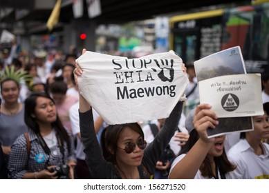BANGKOK - SEPTEMBER 22 : Protester's sign showing as Stop EHIA campaign at Pathum Wan Intersection on September 22,2013 in Bangkok, Thailand.