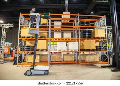 BANGKOK - SEPTEMBER 27 :Unidentified people show checked cargo at Thailand  International Logistic Fair 2014 on Sep 27,2014 in BITEC ,Bangkok,  Thailand.