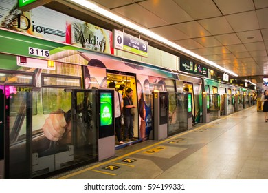 Bangkok Sky Train March 3, 2017 Thailand: The hustle and bustle of city life. A place that is bustling with people or activity is full of people who are very busy or lively.
