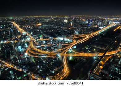 Bangkok skyline at night with roads