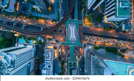 Bangkok skyline and skyscraper with bridge link between mrt and bts mass transportation on Sathorn Road center of business in Bangkok, Aerial top view, Bangkok, Thailand