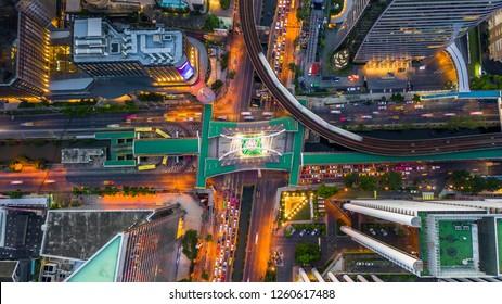 Bangkok skyline and skyscraper with bridge link between mrt and bts mass transportation on Sathorn Road center of business in Bangkok, Aerial top view, Bangkok, Thailand.