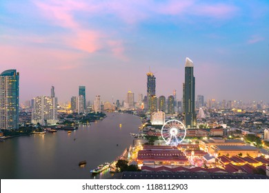 Bangkok skyline and skyscraper with light trails   business in Bangkok downtown. Chao Phraya River Bangkok Thailand at sunset.