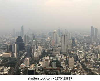 Bangkok skyscraper with dust pollution effects from skywalk rooftop at Mahanakorn tower, Bangkok, Thailand