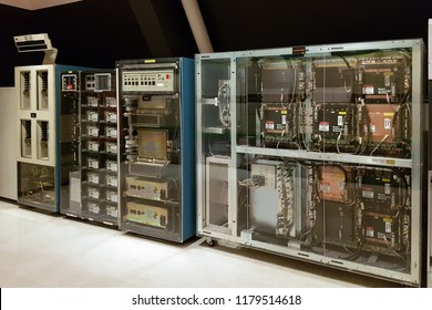 Bangkok, TH - AUGUST 28, 2018: The old dusty vintage mainframe computer towers with many tapes, cables and electrical mainboards, showing in the Information Technology Museum.