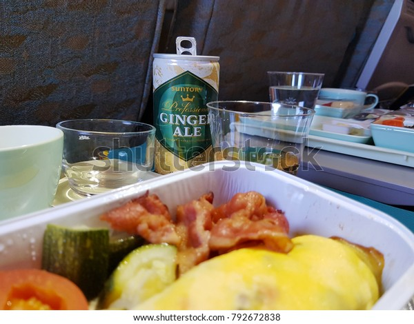 Bangkok, TH - DECEMBER 22, 2017: Food serving on board of Vietnam Airlines flight VN602, Economy class cabin from Bangkok to Ho Chi Minh City.