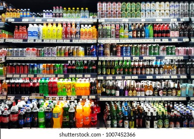 Bangkok, TH - JANUARY 18, 2018: Various of soft drinks, waters, soda, milks and beers are sale on the refrigerator cooler shelf in a hypermarket.